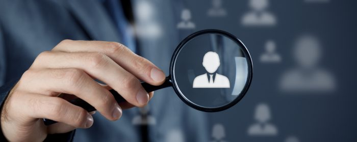 Individual customer service care, personalization, marketing segmentation and targeting, customer relationship management (CRM) and headhunter human resources concepts. Businessman with magnifying glass focused on one person.